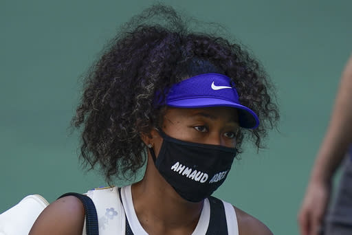 Naomi Osaka, of Japan, walks off the court after winning a match against Marta Kostyuk, of the Ukraine, during the third round of the US Open tennis championships, Friday, Sept. 4, 2020, in New York. (AP Photo/Seth Wenig)