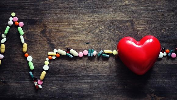 EKG made of pills with a big heart.
