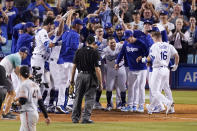 Members of the Los Angeles Dodgers celebrate as Will Smith, right, scores after hitting a three-run walk off home run during the ninth inning of a baseball game against the San Francisco Giants Tuesday, July 20, 2021, in Los Angeles. (AP Photo/Mark J. Terrill)