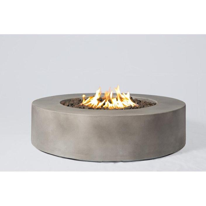 """Get yourself a concrete fire pit like this one and you just might find yourself throwing more outdoor barbecues than ever before! It's weather resistant, has an adjustable flame level, and can be switched to run on natural gas with a conversion kit (not included). $625, Wayfair. <a href=""""https://www.wayfair.com/outdoor/pdp/orren-ellis-grice-concrete-propanenatural-gas-fire-pit-table-w002606757.html"""" rel=""""nofollow noopener"""" target=""""_blank"""" data-ylk=""""slk:Get it now!"""" class=""""link rapid-noclick-resp"""">Get it now!</a>"""