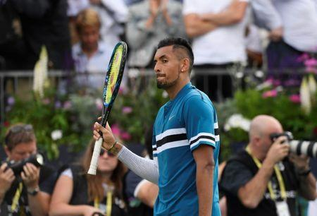 Tennis - ATP 500 - Fever-Tree Championships - The Queen's Club, London, Britain - June 19, 2018 Australia's Nick Kyrgios reacts after winning his first round match against Great Britain's Andy Murray Action Images via Reuters/Tony O'Brien