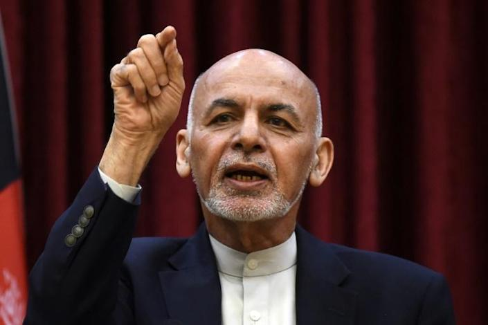 Afghan President Ashraf Ghani blames both the maternity assault and the funeral bombing on the Taliban and the Islamic State group (AFP Photo/WAKIL KOHSAR)