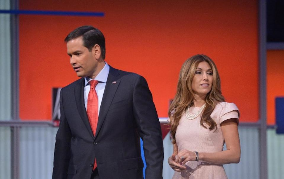 Florida Senator Marco Rubio, pictured with his wife Jeanette Dousdebes following the Republican presidential primary debate on August 6, 2015, is aided by Jamie Fly, who worked on president George W. Bush's national security team (AFP Photo/Mandel Ngan)