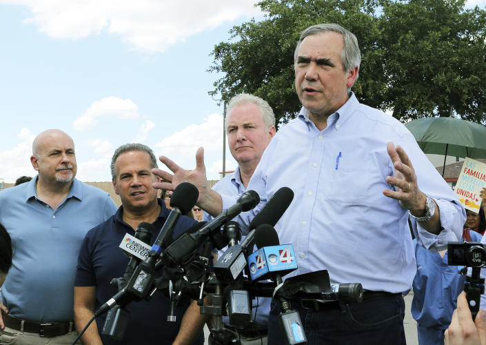 Sen. Jeff Merkley, D-Ore., right, speaks in front of the U.S. Customs and Border Protection's Rio Grande Valley Sector's Centralized Processing Center in McAllen, Texas, June 17, 2018. (Photo: Joel Martinez/the Monitor via AP)