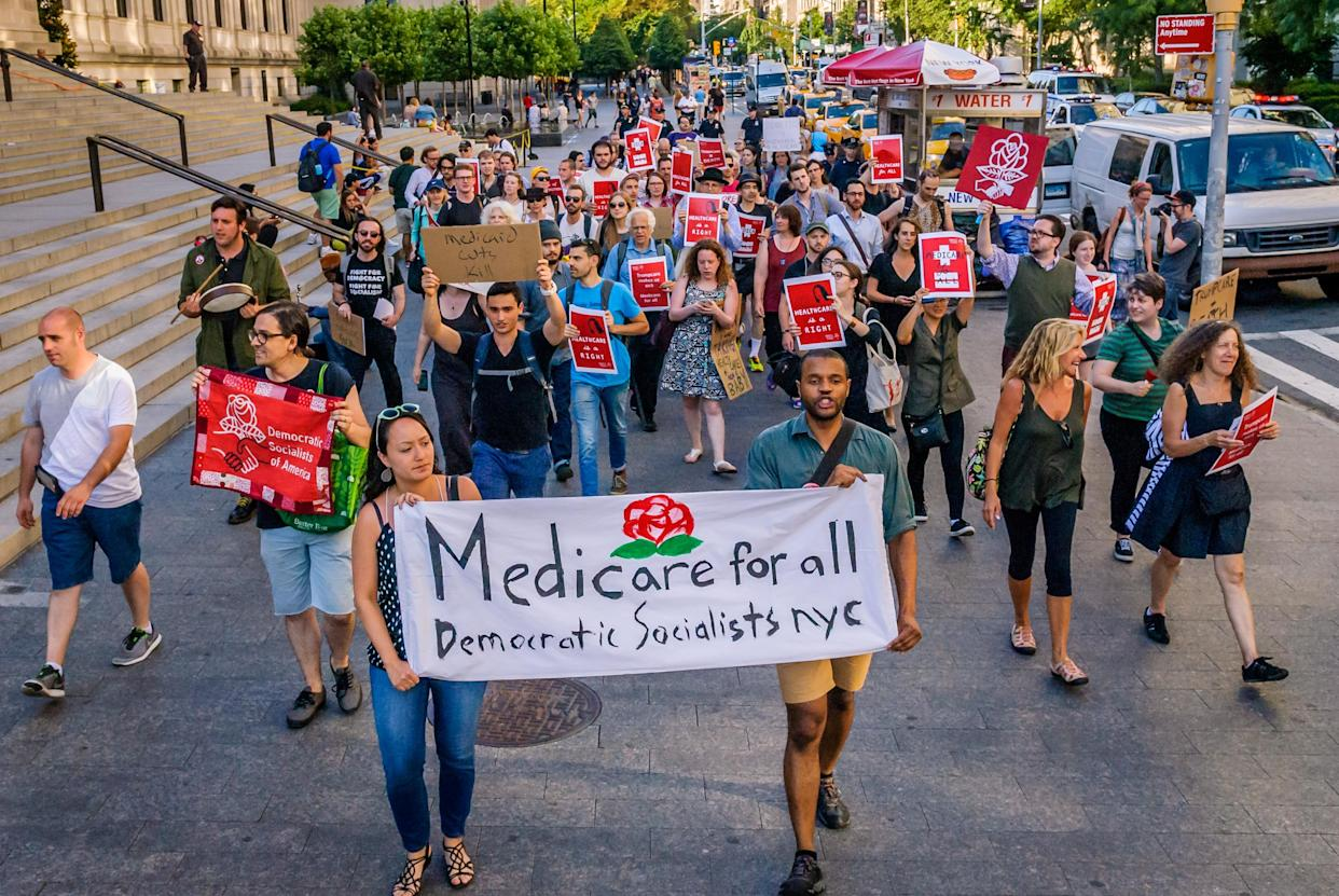 Supporters of the Democratic Socialists of America protest outside the New York County Republicans office in New York City, July 5, 2017. (Photo: Erik McGregor/Pacific Press/LightRocket via Getty Images)