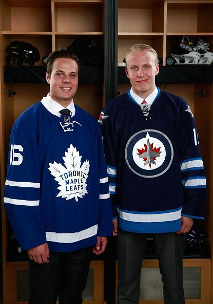 """BUFFALO, NY – JUNE 24: <a class=""""link rapid-noclick-resp"""" href=""""/nhl/players/7109/"""" data-ylk=""""slk:Auston Matthews"""">Auston Matthews</a>, left, selected first overall by the Toronto Maple Leafs, and <a class=""""link rapid-noclick-resp"""" href=""""/nhl/players/7110/"""" data-ylk=""""slk:Patrik Laine"""">Patrik Laine</a>, right, selected second overall by the <a class=""""link rapid-noclick-resp"""" href=""""/nhl/teams/wpg/"""" data-ylk=""""slk:Winnipeg Jets"""">Winnipeg Jets</a>, pose for a portrait during round one of the 2016 NHL Draft at First Niagara Center on June 24, 2016 in Buffalo, New York. (Photo by Jeff Vinnick/NHLI via Getty Images)"""