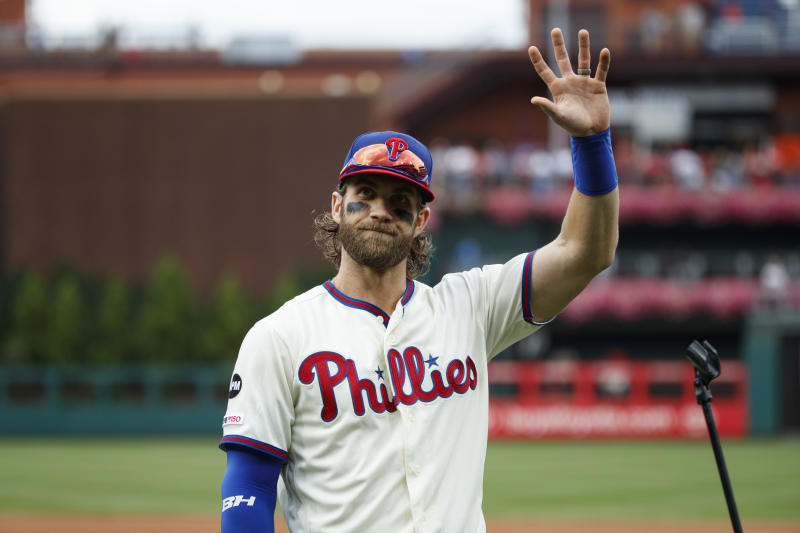 Philadelphia Phillies' Bryce Harper waves before addressing the crowd at Citizens Bank Park before a baseball game against the Miami Marlins, Sunday, Sept. 29, 2019, in Philadelphia. (AP Photo/Matt Slocum)