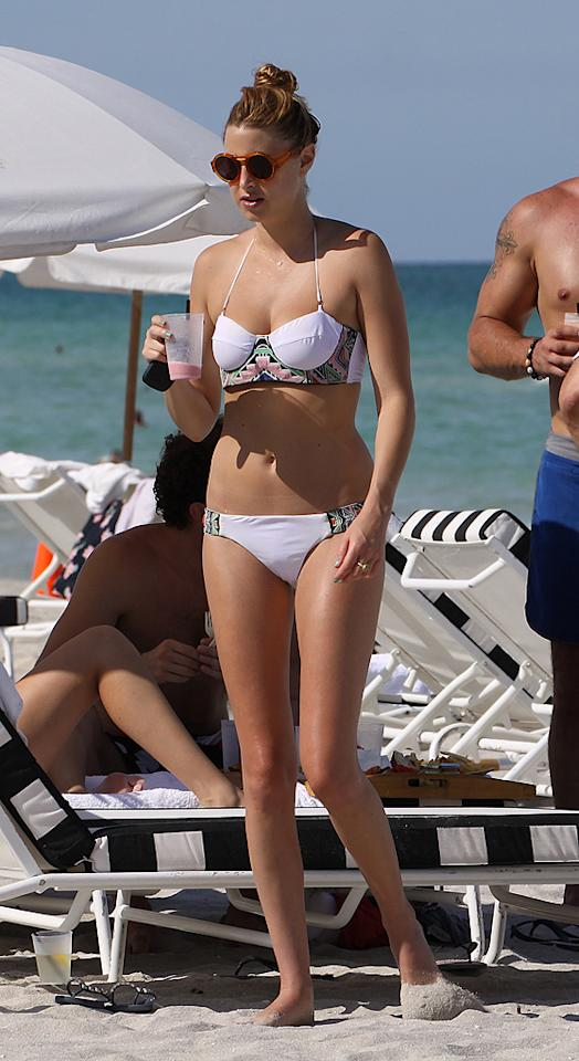 """Designer/former reality star Whitney Port was also spotted at a Miami beach, where she donned a two-piece and an interesting pair of round sunglasses. Is her look hot ... or not? JCFL/<a href=""""http://www.splashnewsonline.com/"""" target=""""new"""">Splash News</a> - July 17, 2011"""