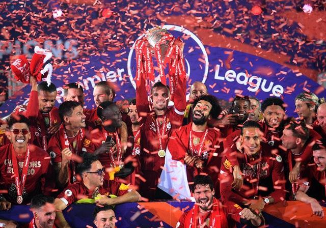 Liverpool captain Jordan Henderson lifts the Premier League trophy. The Reds endured a lengthy wait to secure their first top-flight title in 30 years due to the impact of the coronavirus pandemic. Jurgen Klopp's runaway champions were 25 points clear of Manchester City when play was halted in March and finally guaranteed top spot just eight days after football resumed