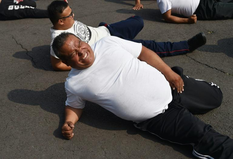 Mexican police officers exercise at a station in Mexico City, part of a program to tackle obesity in the police force (AFP Photo/RODRIGO ARANGUA)