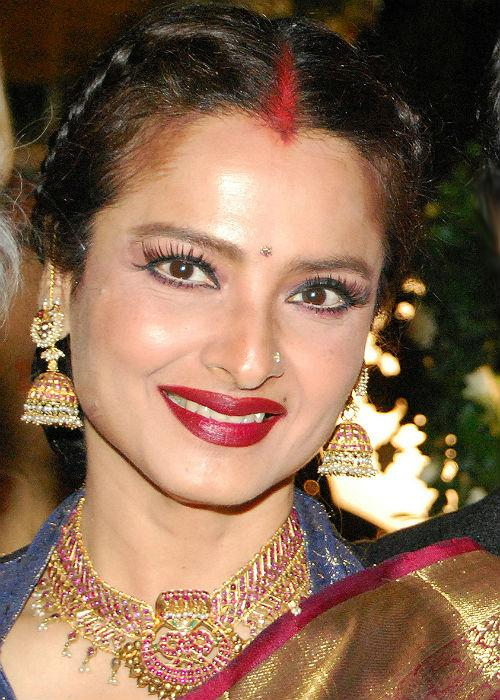 <b>Rekha (Scanty brows)</b><br> One of Bollywood's original divas, Rekha has a lot to teach us in terms of fashion. From elegant Sarees to ethnic jhumkas, Rekha has stood out for many reasons in the fashion world. However, her eye brows scare us! They are scanty and not shaped to define her face. High time she hits the parlor for an eye brow makeover.