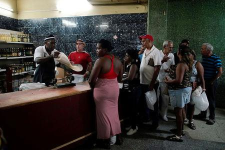 People wait in line to buy rice in a state store in downtown Havana, Cuba, May 10, 2019. REUTERS/Alexandre Meneghini