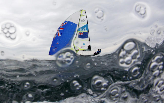 New Zealand's Peter Burling and Blair Tuke sail before the fifth race of the men's 49er sailing class at the London 2012 Olympic Games in Weymouth and Portland, southern England, August 1, 2012. REUTERS/Pascal Lauener (BRITAIN - Tags: SPORT YACHTING OLYMPICS TPX IMAGES OF THE DAY)