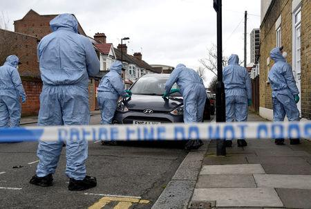Forensic investigators examine a car on Chalgrove Road, where a teenage girl was murdered, in Tottenham, Britain, April 3, 2018. REUTERS/Toby Melville