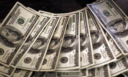 Four thousand U.S. dollars are counted out by a banker counting currency at a bank in Westminster