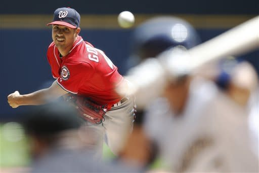 Washington Nationals starting pitcher Gio Gonzalez throws to a Milwaukee Brewers batter during the first inning of a baseball game on Sunday, July 29, 2012, in Milwaukee. (AP Photo/Tom Lynn)
