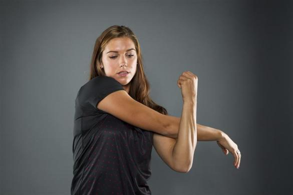 Soccer player Alex Morgan stretches while posing for a portrait during the 2012 U.S. Olympic Team Media Summit in Dallas, May 15, 2012.