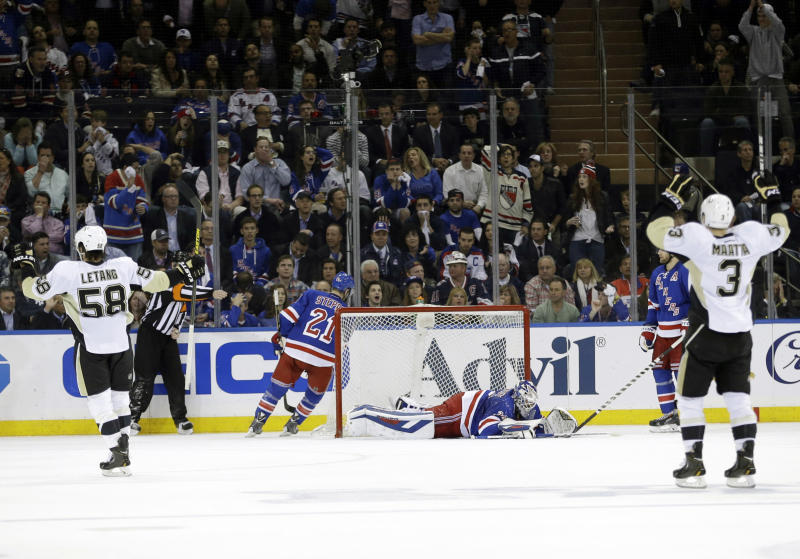 Pittsburgh Penguins' Olli Maatta (3) and Kris Letang (58) celebrate a goal by Brandon Sutter as New York Rangers goalie Henrik Lundqvist, center, of Sweden, reacts during the second period of a second-round NHL Stanley Cup hockey playoff series Wednesday, May 7, 2014, in New York. (AP Photo/Frank Franklin II)