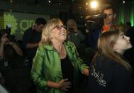 Green Party leader Elizabeth May watches as results come in during election night at Crystal Gardens in Victoria, B.C., on Monday, October 21, 2019. THE CANADIAN PRESS/Chad Hipolito