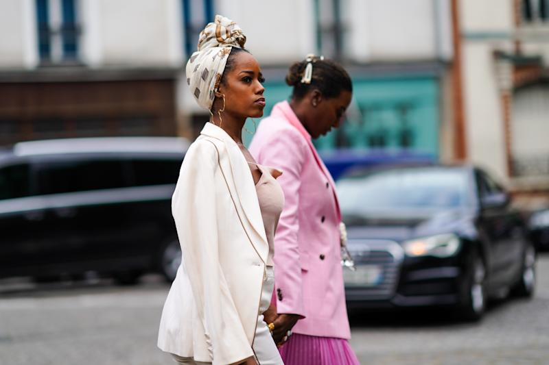 PARIS, FRANCE - JUNE 22: A guest wears a hair scarf, large earrings representing a map, an old-pink strappy top, a cream-color jacket, outside Hermes, during Paris Fashion Week - Menswear Spring/Summer 2020, on June 22, 2019 in Paris, France. (Photo by Edward Berthelot/Getty Images)