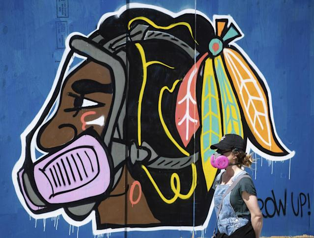 "<span class=""element-image__caption"">The Chicago Blackhawk logo is depicted wearing a respirator during the Covid-19 pandemic.</span> <span class=""element-image__credit"">Photograph: Darryl Dyck/AP</span>"