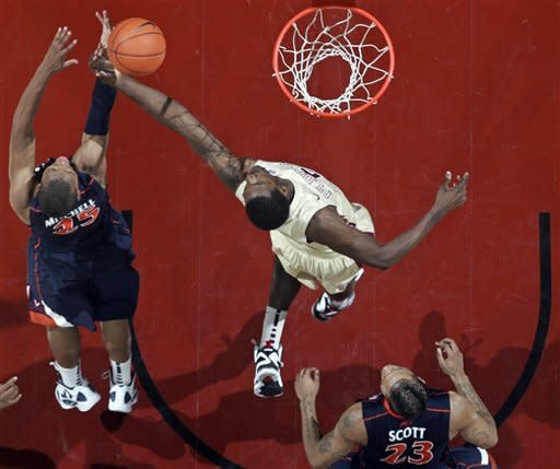 Florida State's Bernard James, cente,r gets above Virginia's Akil Mitchell (25) for a rebound in the first half of an NCAA college basketball game on Saturday, Feb. 4, 2012, in Tallahassee, Fla. (AP Photo/Phil Sears)