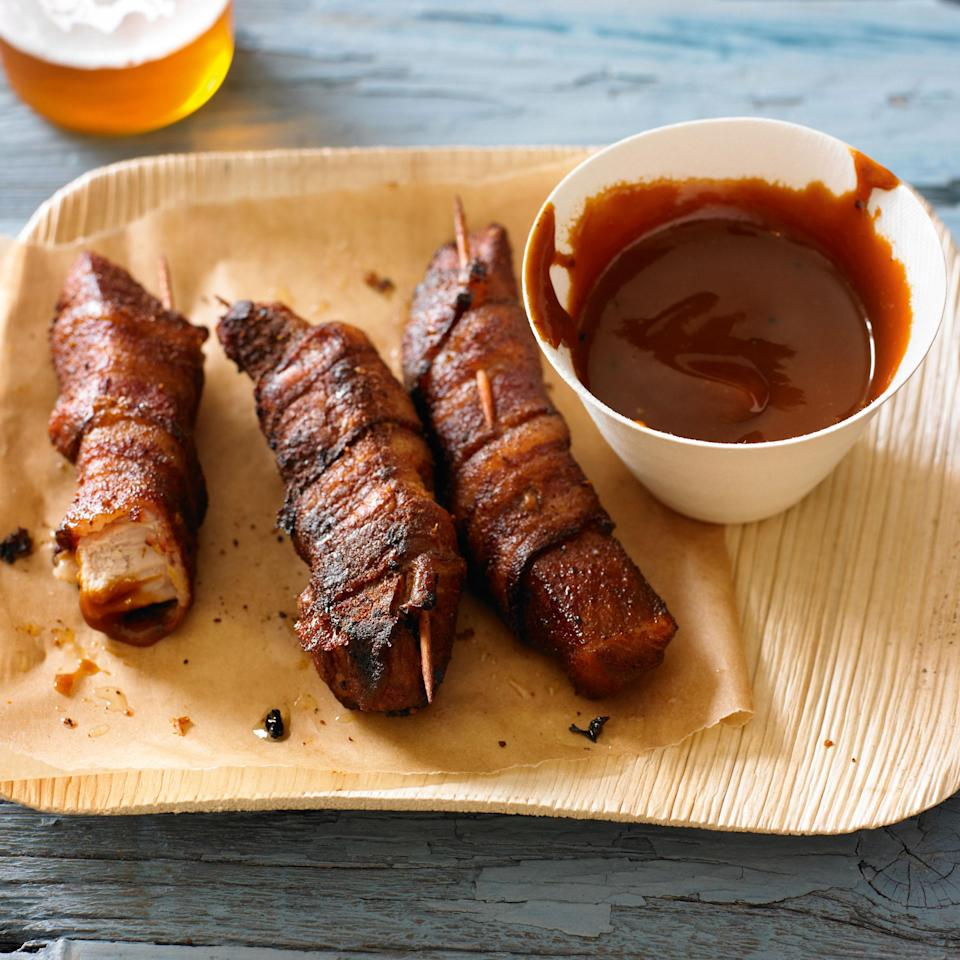 """This recipe doubles down on pork. Pork chop meat is wrapped in bacon and then cooked to crispy, smoky perfection. <a href=""""https://www.epicurious.com/recipes/food/views/bacon-wrapped-pig-wings-395690?mbid=synd_yahoo_rss"""" rel=""""nofollow noopener"""" target=""""_blank"""" data-ylk=""""slk:See recipe."""" class=""""link rapid-noclick-resp"""">See recipe.</a>"""