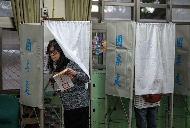 PHOTO: A woman exits a polling booth as she casts her vote in the presidential election on Jan. 11, 2020 in Taipei, Taiwan. (Carl Court/Getty Images, FILE)