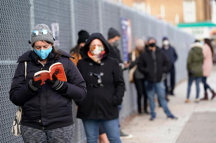 Wealthy New Yorkers have paid other residents to wait in coronavirus testing lines for them  (AP)
