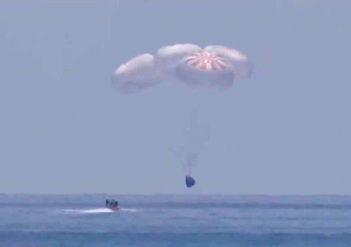 In this screen grab from NASA TV, SpaceX 's Crew Dragon capsule spacecraft just before it splashes down in to the water after completing NASA's SpaceX Demo-2 mission to the International Space Station with NASA astronauts Robert Behnken and Douglas Hurley onboard, August 2, 2020 off the coast of Pensacola, Florida in the Gulf of Mexico.