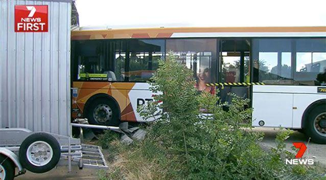 One of the buses went through a fence and crashed into a shed. Source: 7 News