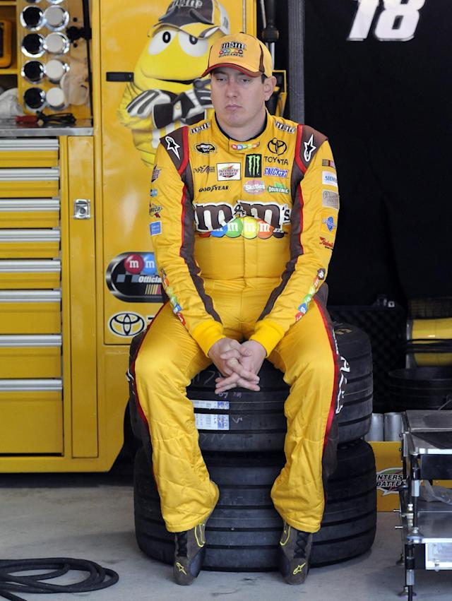 Kyle Busch waits in the garage for the first round of qualifying for Sunday's NASCAR Sprint Cup Series auto race, at Martinsville Speedway in Martinsville, Va., Friday, March 28, 2014. (AP Photo/Mike McCarn)