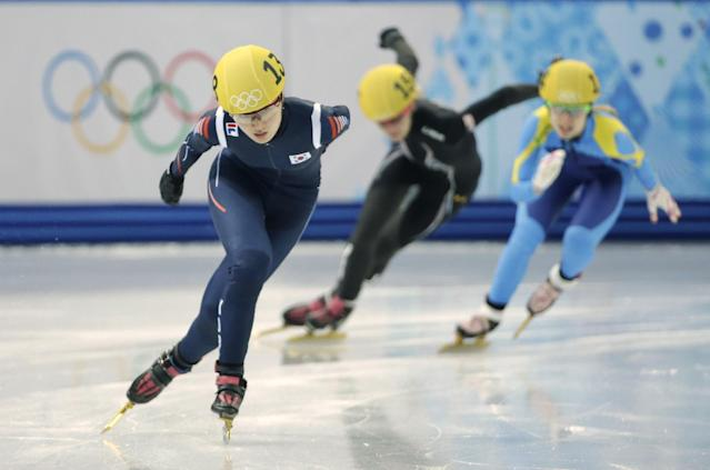 Park Seung-hi of South Korea leads in a women's 1000m short track speedskating heat at the Iceberg Skating Palace during the 2014 Winter Olympics, Tuesday, Feb. 18, 2014, in Sochi, Russia. (AP Photo/David J. Phillip )