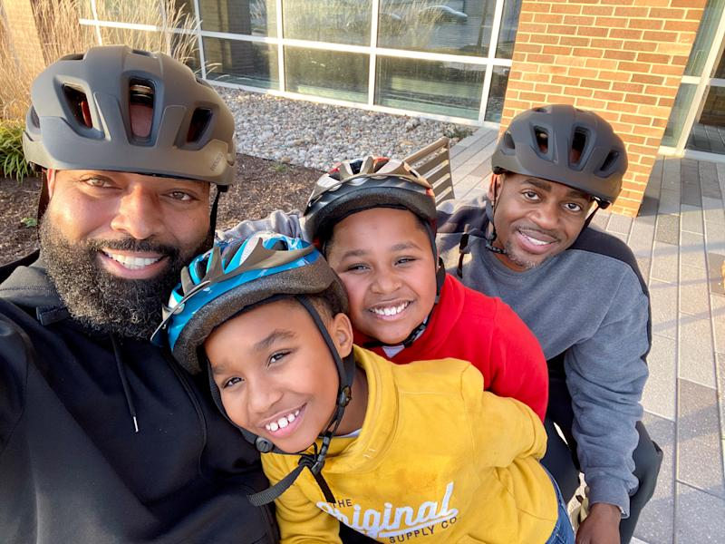 "Rodney Chambers, left, and Ron Covington with sons Charles and Carlos. The family was one of six that took part in a now-viral video, ""Don't Rush Challenge: Black Gay Dads Edition."" They're now talking out about the meaning of Father's Day. (Photo courtesy of Rodney Chambers)"