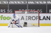 Toronto Maple Leafs goalie David Rittich, of the Czech Republic, allows a goal to Vancouver Canucks' Nils Hoglander during the third period of an NHL hockey game in Vancouver, British Columbia on Tuesday, April 20, 2021. (Darryl Dyck/The Canadian Press via AP)