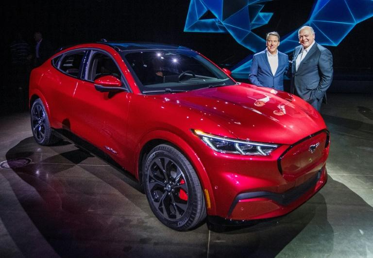 Ford CEO James Hackett (R), shown here at the November 2019 unveiling of the Mustang Mach-E, vowed that the all-electric vehicle will help turn around Ford's fortunes (AFP Photo/Mark RALSTON)