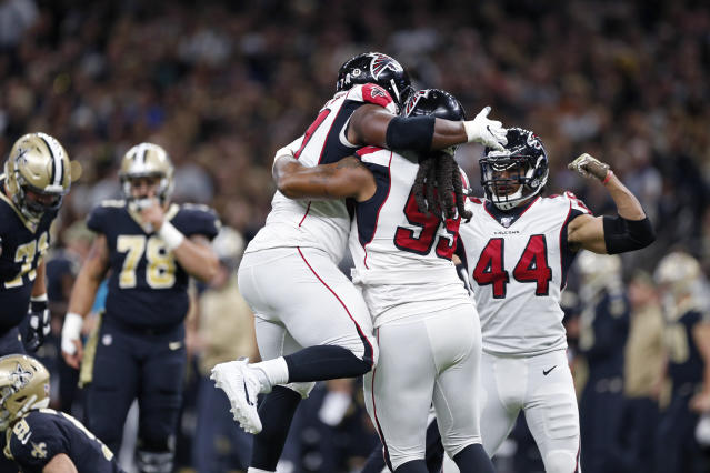 Atlanta Falcons defensive tackle Grady Jarrett, defensive end Adrian Clayborn (99) and defensive end Vic Beasley (44) celebrate in the first half of an NFL football game against the New Orleans Saints in New Orleans, Sunday, Nov. 10, 2019. (AP Photo/Rusty Costanza)