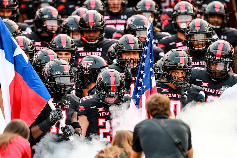 LUBBOCK, TEXAS - SEPTEMBER 12: Defensive back Eric Monroe #11, receiver Sterling Galban #22, and receiver Seth Collins #0 of the Texas Tech Red Raiders lead their teammates onto the field before the college football game against the Houston Baptist Huskies on September 12, 2020 at Jones AT&T Stadium in Lubbock, Texas. (Photo by John E. Moore III/Getty Images)