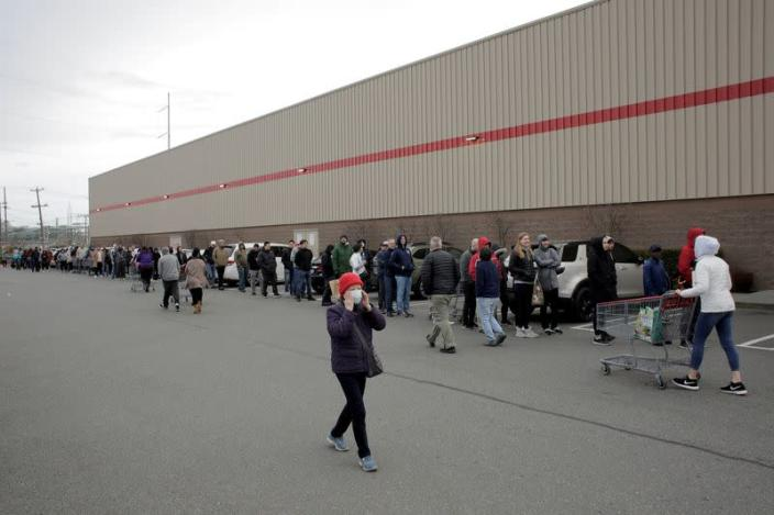 Shoppers line up before opening at a Costco store, following reports of coronavirus disease (COVID-19) cases in the country, in Seattle