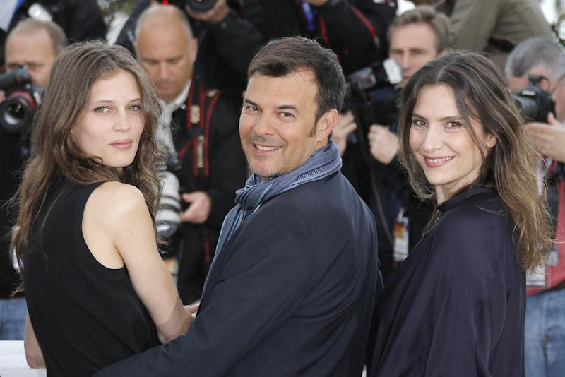 From left, actress Marine Vacth, director Francois Ozon and actress Geraldine Pailhas poses for photographers during a photo call for the film Young & Beautiful at the 66th international film festival, in Cannes, southern France, Thursday, May 16, 2013. (AP Photo/Lionel Cironneau)