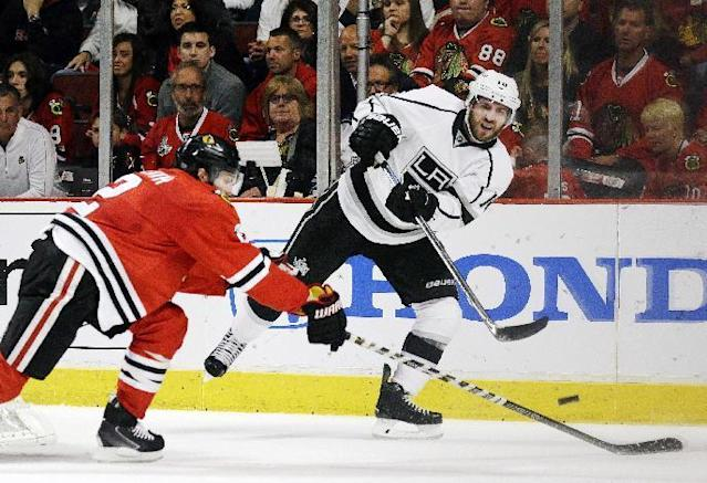 """FILE - In this May 28, 2014, file photo, Los Angeles Kings center Mike Richards (10) keeps the puck away from Chicago Blackhawks defenseman Duncan Keith (2) during a power play in the first period in Game 5 of the Western Conference finals in the NHL hockey Stanley Cup playoffs in Chicago. The Los Angeles Kings terminated Mike Richards' contract Monday, June 29, 2015, claiming the forward committed a """"material breach"""" of its terms. (AP Photo/Nam Y. Huh, File)"""