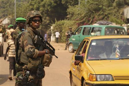 A French soldier carries his weapon as he takes a strategic position during a joint Chad MISCA French army patrol in Wouango district