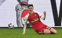 Freiburg's Roland Sallai, celebrates after he scored the second goal during the German Bundesliga soccer match between FC Schalke 04 and SC Freiburg at the Arena in Gelsenkirchen, Germany, Wednesday, Dec. 16, 2020. (AP Photo/Martin Meissner, Pool)