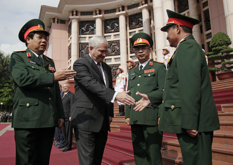 Vietnam's Minister of Defense General Phung Quang Thanh, from left, introduces U.S. Defense Secretary Robert Gates, to Lt. Gen. Nguyen Chi Vinh, and Lt. Gen. Khue, right, at the Vietnam Ministry of Defense in Hanoi, Vietnam, Monday, Oct. 11, 2010.  (AP Photo/Carolyn Kaster, Pool)
