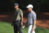 Georgia Tech alumn Andy Ogletree, right, plays with Tiger Woods on the 10th green during the first round of the Masters golf tournament Thursday, Nov. 12, 2020, in Augusta, Ga. (Curtis Compton/Atlanta Journal-Constitution via AP)