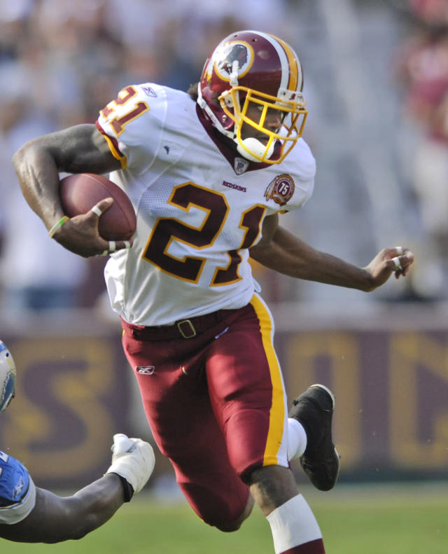 ** FILE ** Washington Redskins safety Sean Taylor (21) escapes the grasp of Detroit Lions tackle George Foster in an NFL football game at FedEx Field in Landover, Md., in this Oct. 7, 2007 file photo. Taylor was voted to the NFC Pro Bowl team posthumously on Tuesday, Dec. 17, 2007, three weeks after after he was shot during a burglary at his Florida home.(AP Photo/Nick Wass, File)