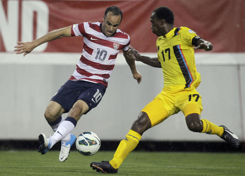 U.S.forward Landon Donovan (10) controls the ball in front of Antigua and Barbuda defender George Dublin (17) during the first half of a FIFA World Cup qualifying soccer game Friday, June 8, 2012, in Tampa, Fla. (AP Photo/Chris O'Meara)