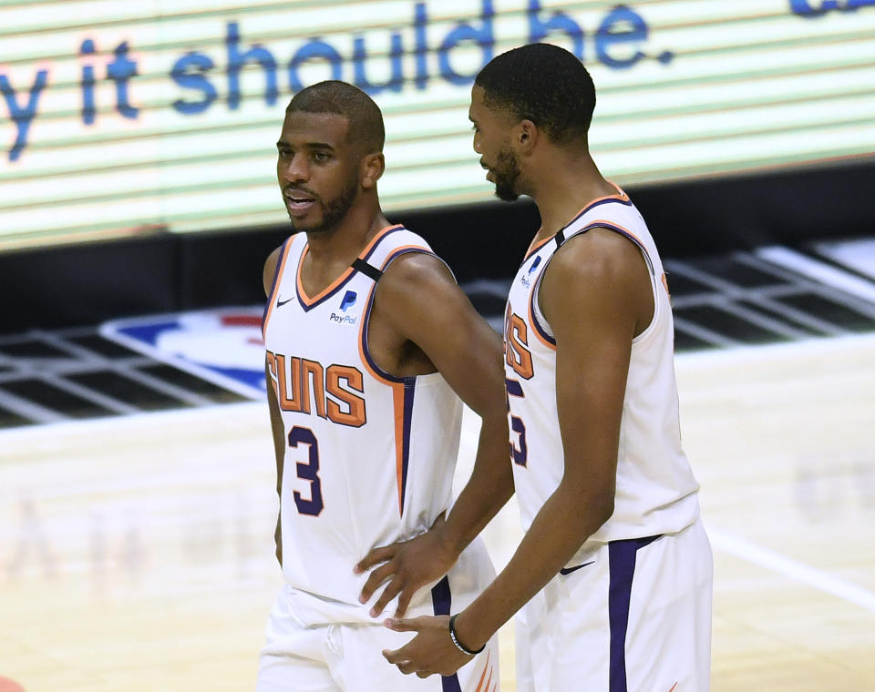 Chris Paul #3 of the Phoenix Suns and Mikal Bridges #25 talk during the fourth quarter in a 113-103 LA Clippers win at Staples Center on April 08, 2021 in Los Angeles, California. (Photo by Harry How/Getty Images) NOTE TO USER: User expressly acknowledges and agrees that, by downloading and or using this photograph, User is consenting to the terms and conditions of the Getty Images License Agreement.
