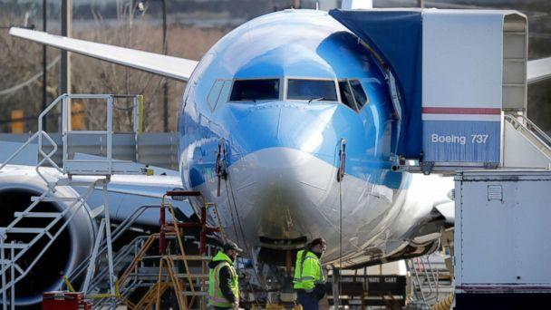 PHOTO: Workers walk past a Boeing 737 MAX 8 airplane being built at Boeing Co.'s Renton Assembly Plant Wednesday, March 13, 2019, in Renton, Wash. (Ted S. Warren/AP)