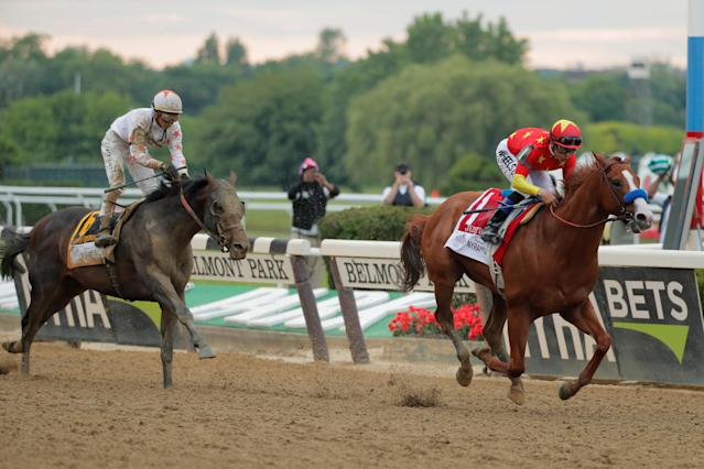 Justify with jockey Mike Smith aboard wins the 150th running of the Belmont Stakes, the third leg of the Triple Crown of Thoroughbred Racing at Belmont Park in Elmont, New York, U.S., June 9, 2018. REUTERS/Lucas Jackson